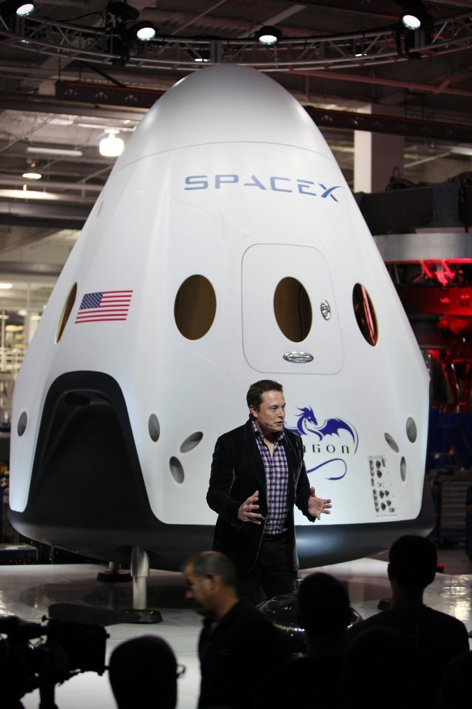 elon-with-the-SpaceX-dragon-682x1024